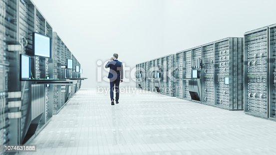 Server room with businessman.