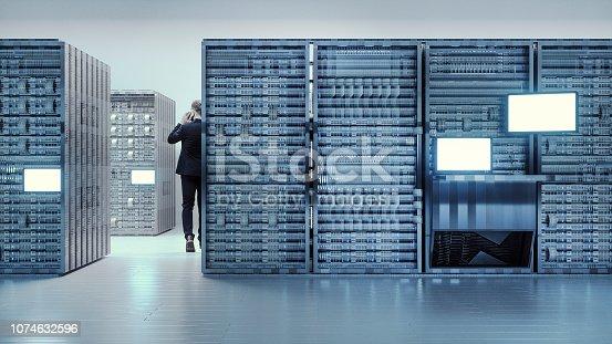 802303672istockphoto Server room with businessman 1074632596