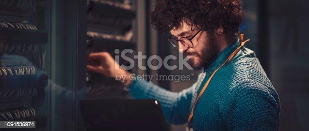 802303638istockphoto Server rooms 1094536974