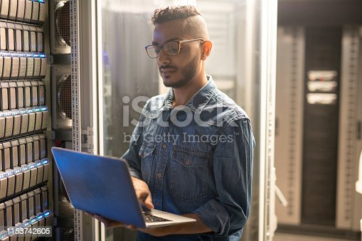 istock Server specialist doing network monitoring 1153742605