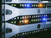 server units in cloud service data center showing flickering light indicators for massive data connection bandwidth
