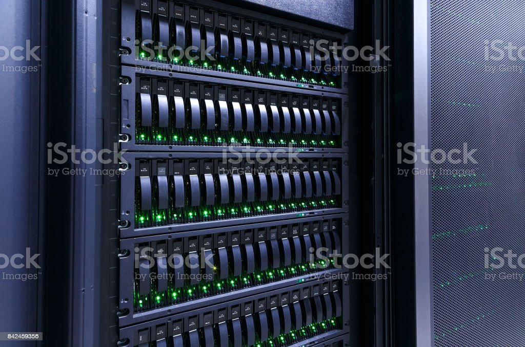 servers stack with hard drives in datacenter for backup and data storage stock photo