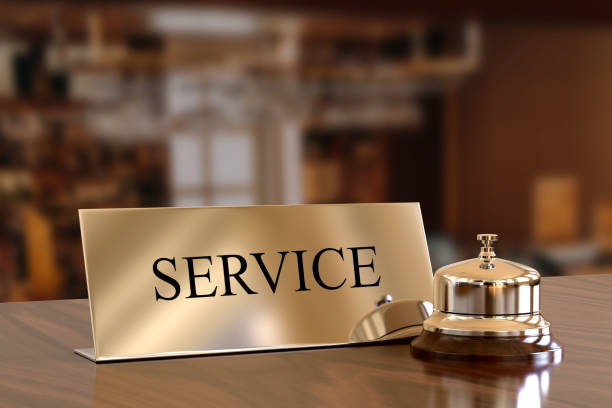 Service bell on hotel reception desk Hotel Reception, Hotel, Motel, Desk, Welcome Sign concierge stock pictures, royalty-free photos & images