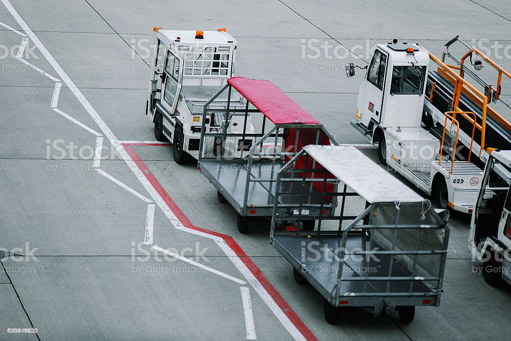 Service cars with cargo pallets in the airport