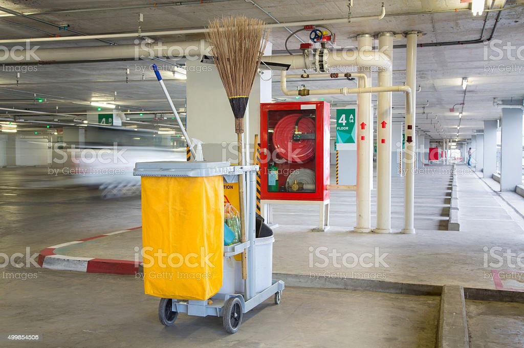 Service cart with cleaning accessories stock photo