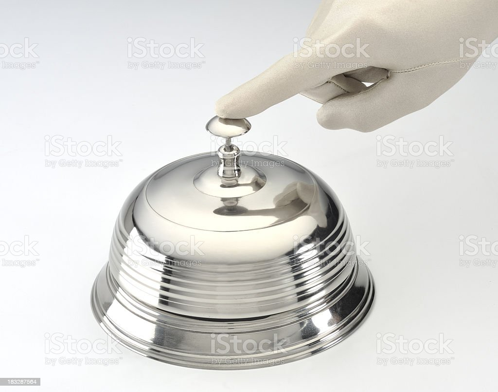 Service desk bell with gloved hand royalty-free stock photo