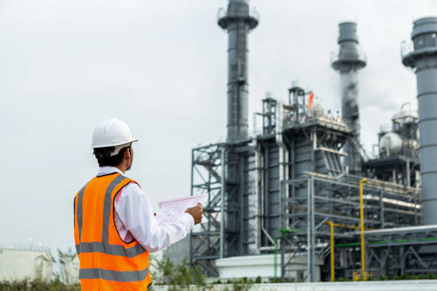 Service engineer is working at gas turbine  electric power plant Service engineer is working at gas turbine  electric power plant power station stock pictures, royalty-free photos & images