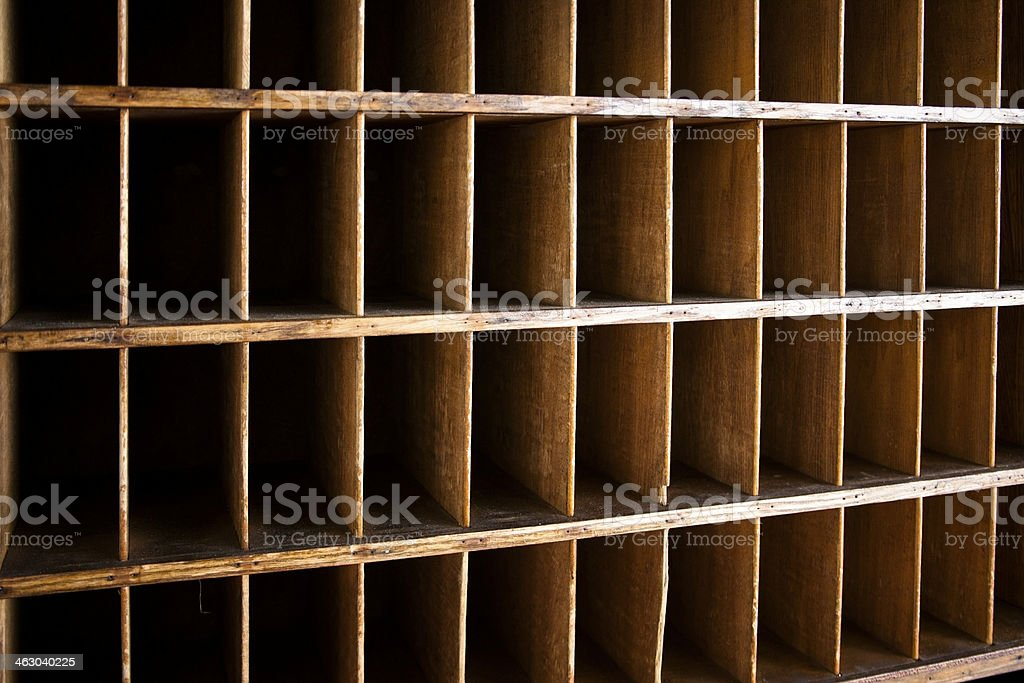 Service Industry:  Antique mail slots used in old hotels, mailrooms. stock photo
