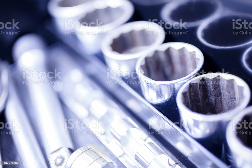 Service Industry: Ratchet and sockets in mechanic's toolbox. stock photo