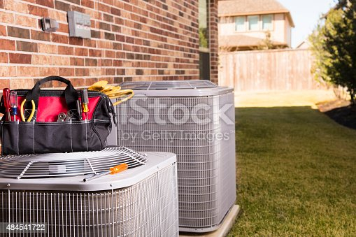 istock Service Industry:  Work tools, air conditioners. Outside residential home. Summer 484541722