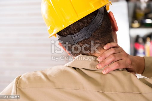 istock Service Industry:  Worker injures neck on the job.  Safety Issues. 181146087