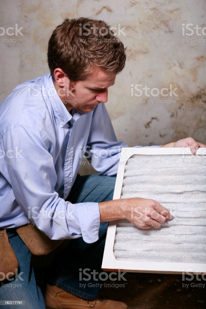 Service Man Changing Furnace Air Filter royalty-free stock photo