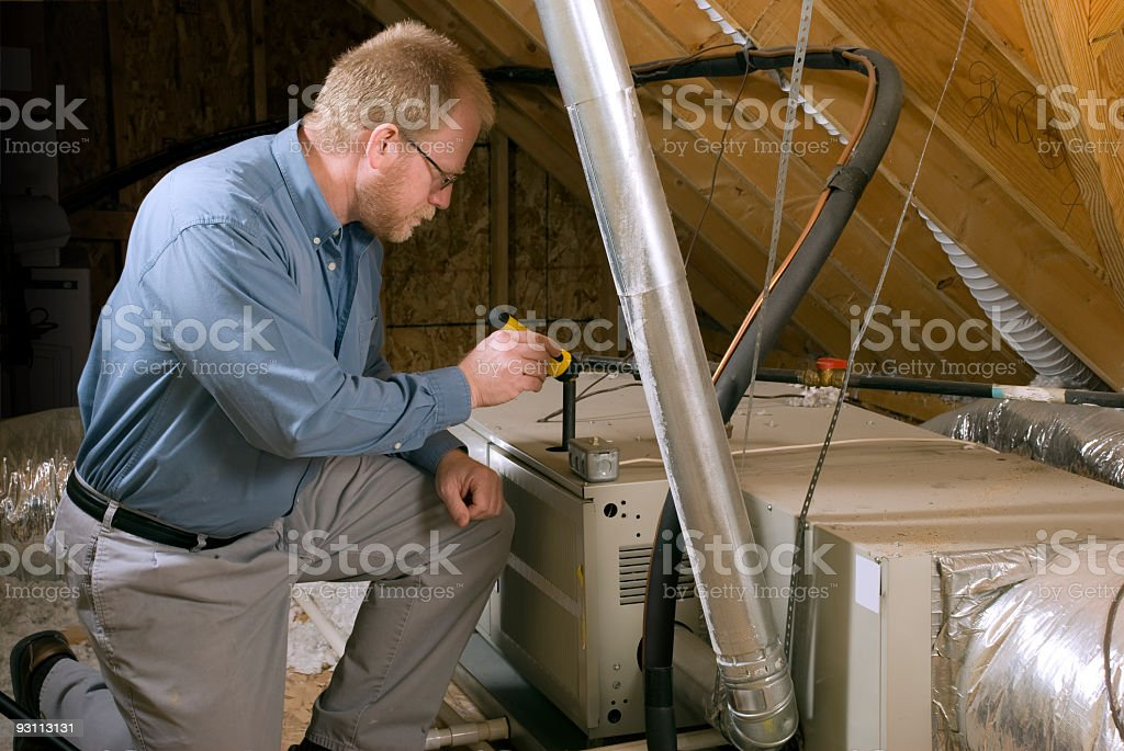 Service Man Inspects Furnace stock photo
