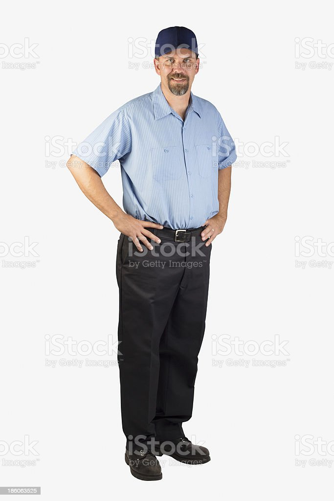 Service Man Standing with Hands on Hips stock photo