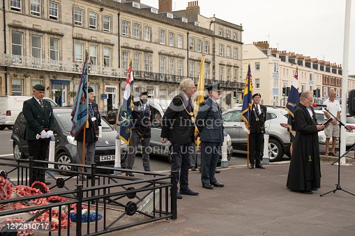 This image shows the 80th anniversary remembrance service held on the seafront at Weymouth, Dorset, United Kingdom on Tuesday 15 September 2020.  Both service men and women attending with the Mayor of Weymouth, Cllr Graham Winter and a local clergyman leading the service