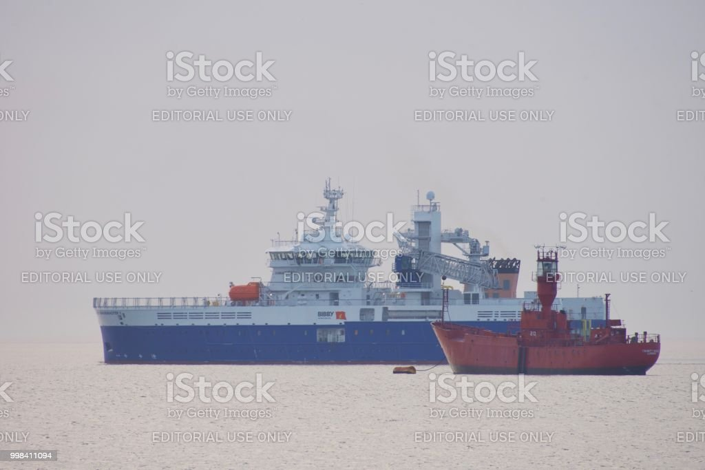 Service operations vessel and light ship stock photo