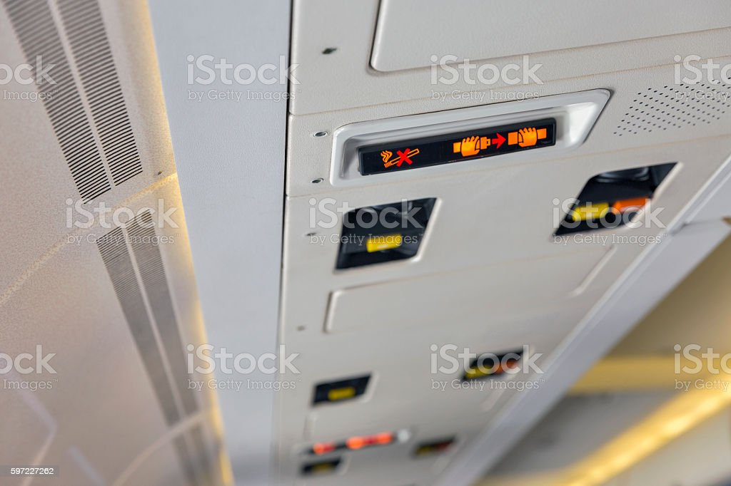 Service panel in passenger airplane closeup stock photo
