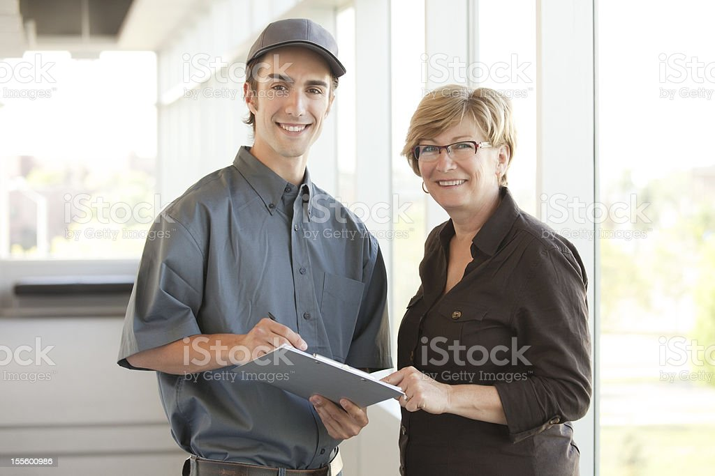 Service Personnel with a Customer stock photo