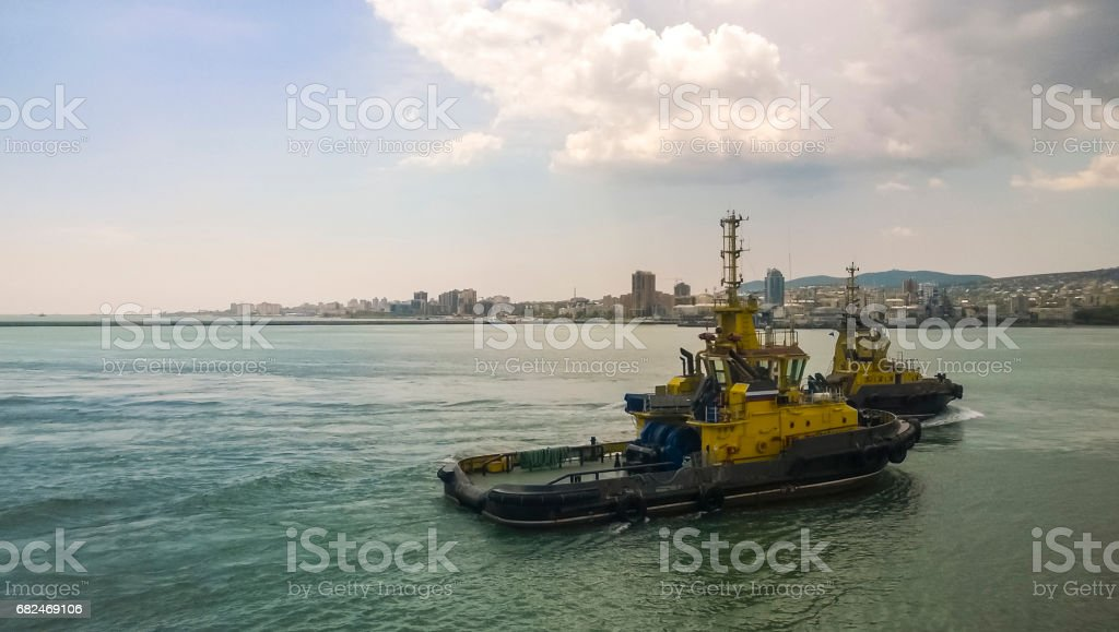 A service small boat in the harbor harbor. Tsemesskaya bay. Industrial port royalty-free stock photo