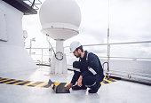 istock Service technician or serviceman near VSAT terminal 1058936702