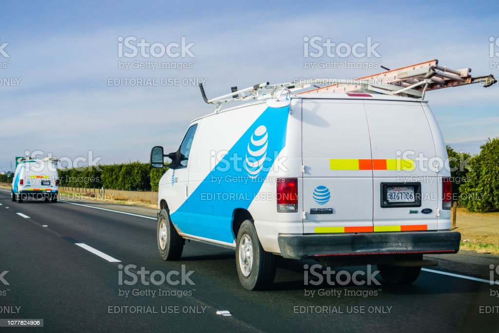 AT&T service vans driving on the freeway stock photo
