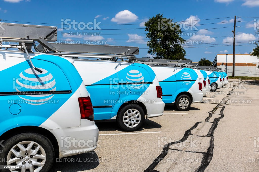 AT&T Service vehicles. AT&T now offers Uverse, VoIP, Cell Phones and DirecTV XVII stock photo