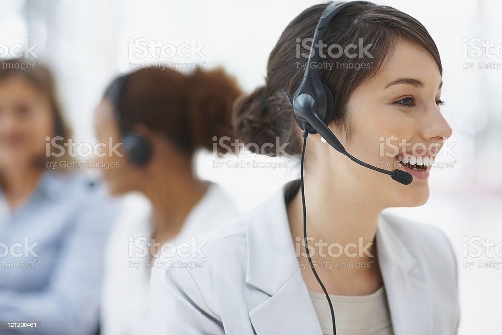 Service with smile - Closeup of pretty call center employee royalty-free stock photo