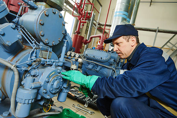 service worker at industrial compressor station stock photo