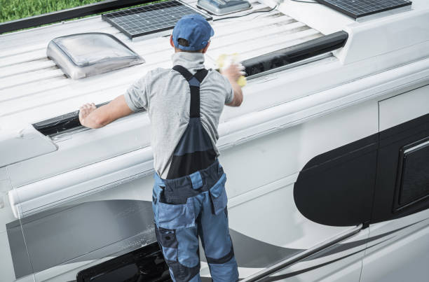 RV Service Worker Cleaning Camper Van Roof stock photo