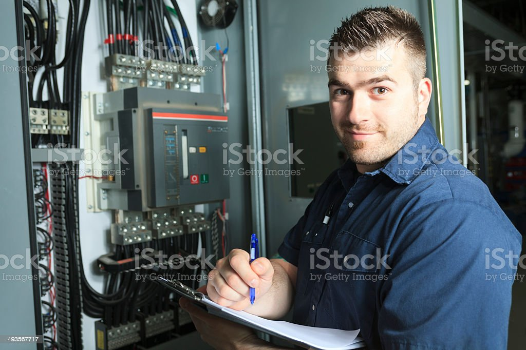 Serviceman - Electricity Note stock photo