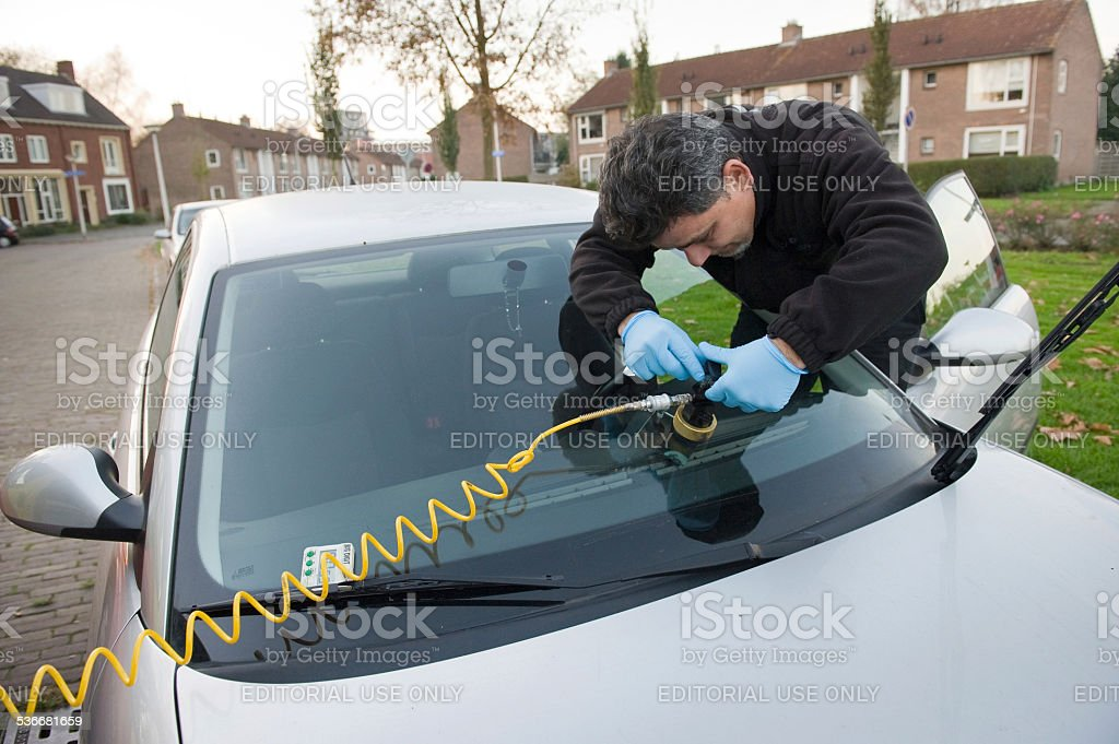 Serviceman from carglass stock photo