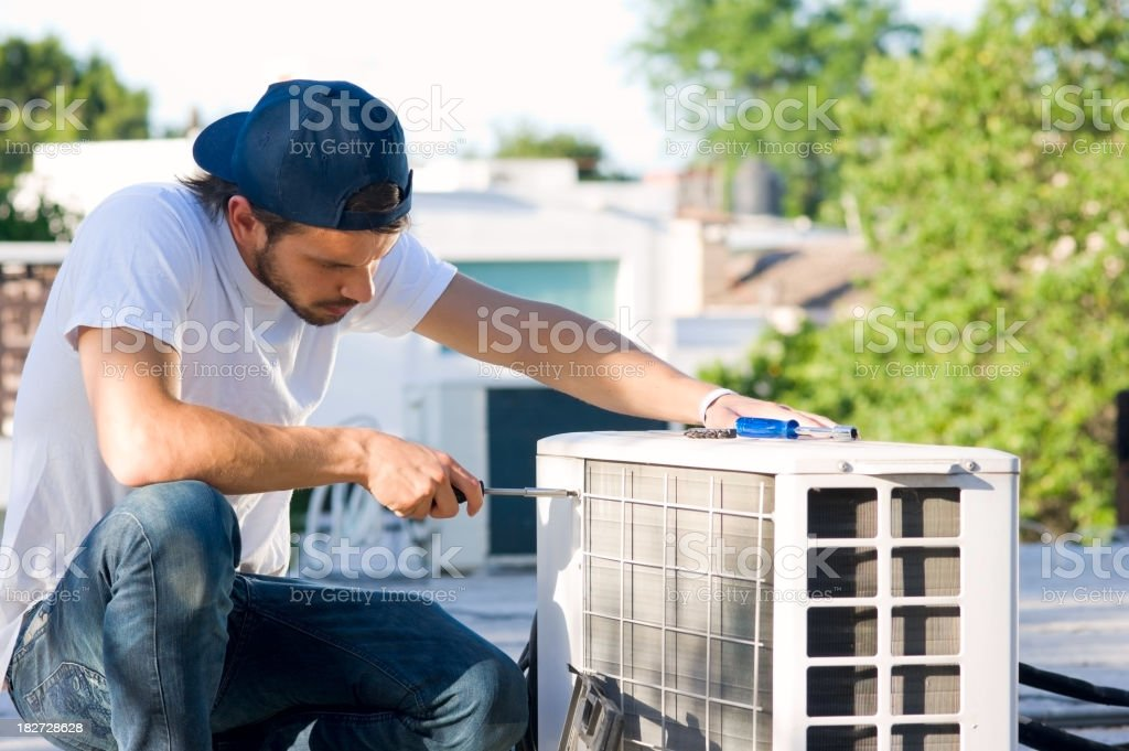 Serviceman with Heat Pump stock photo