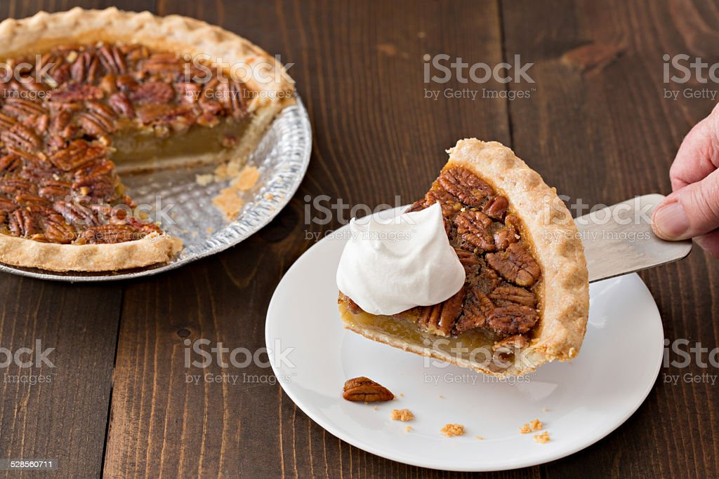 Serving A Slice Of Thanksgiving Pecan Pie stock photo