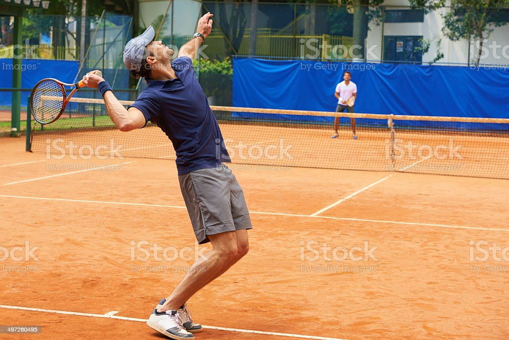 Serving an ace stock photo