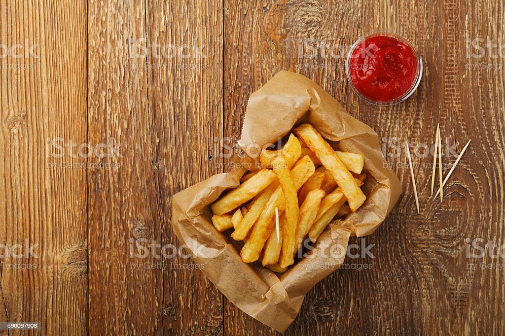 Serving Belgian fries served in a paper box. royalty-free stock photo