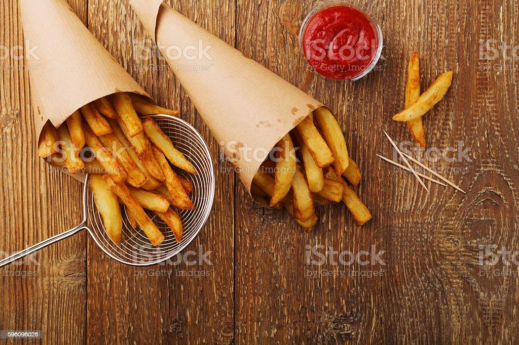 Serving Belgian fries served in a paper tube. Lizenzfreies stock-foto