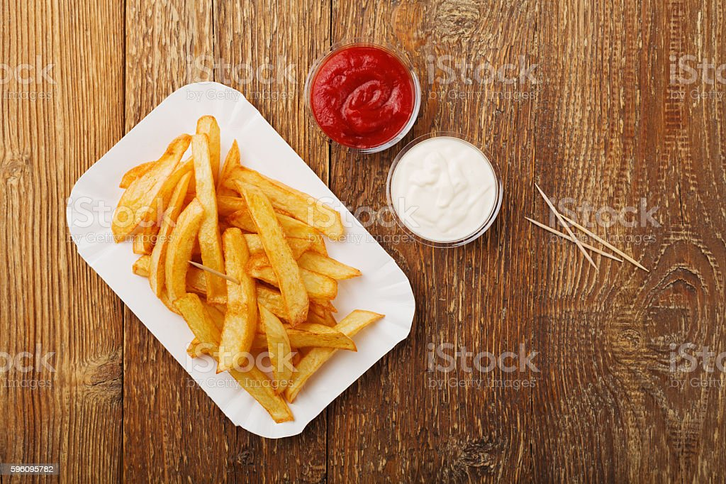 Serving Belgian fries served on a paper tray. royalty-free stock photo