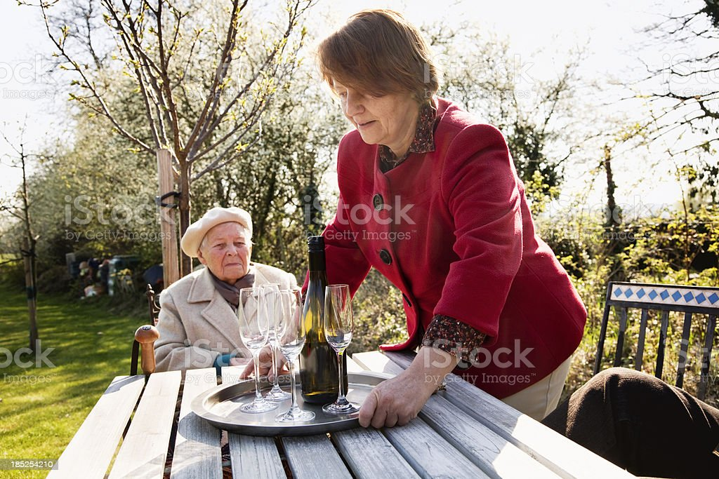 serving champagne outdoors stock photo