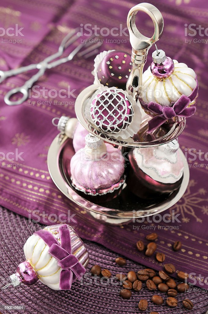 serving christmas ball muffins in a etagere with cake tongs. stock photo