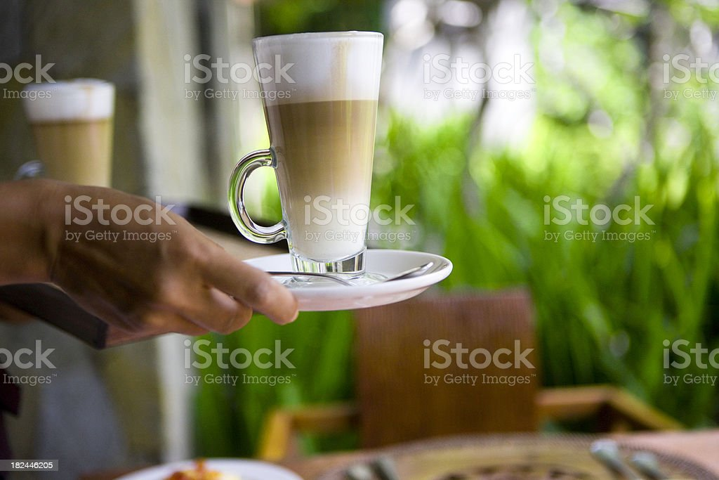 Serving coffee royalty-free stock photo