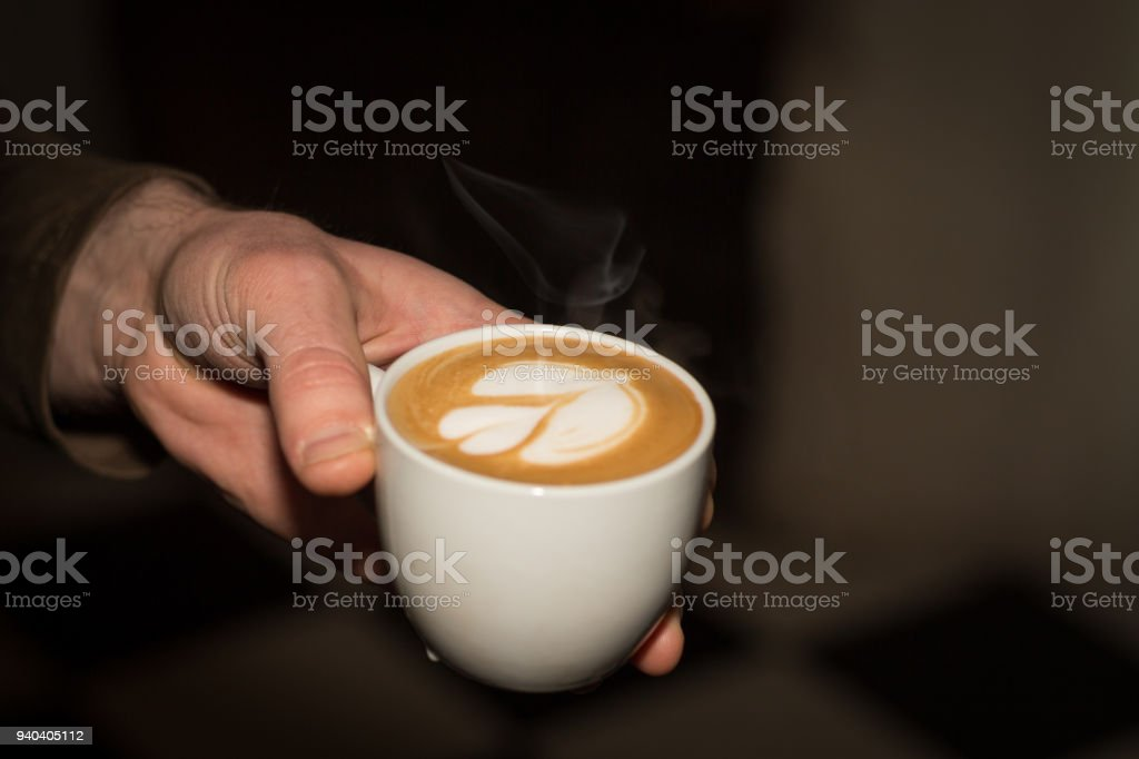 Serving coffee with flower in its foam