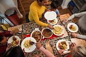 istock Serving Dinner to her Family 923275096