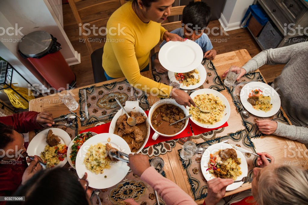 Serving Dinner to her Family stock photo