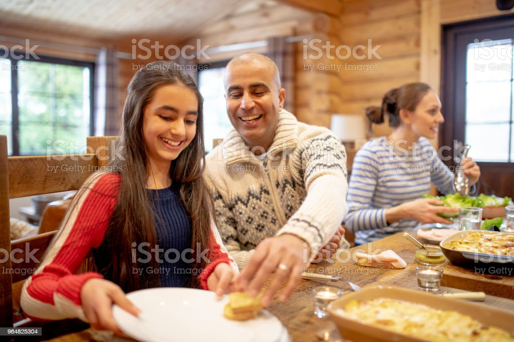 Serving Dinner to his Daughter royalty-free stock photo
