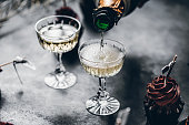 istock Serving drinks for new years party 1266799425