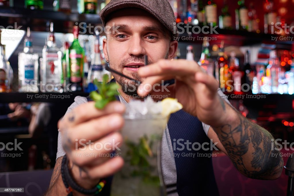 Serving drinks is an art stock photo