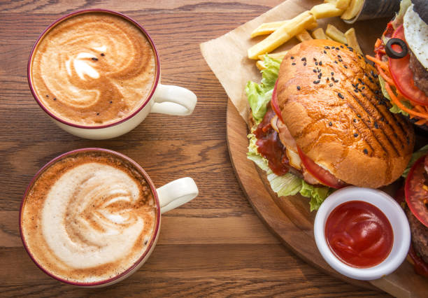 serving fast food and two cups of coffee stock photo