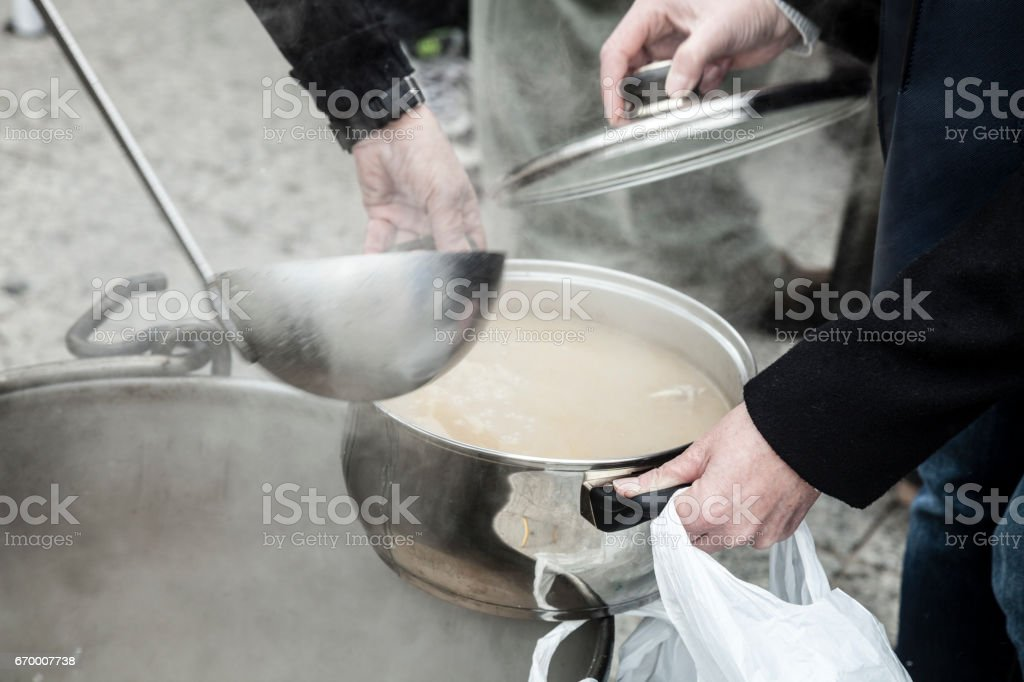 Serving food for poor people stock photo