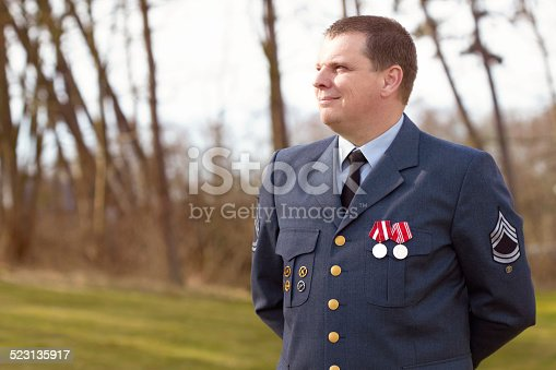 Shot of a high ranking military officer standing at ease in the outdoors