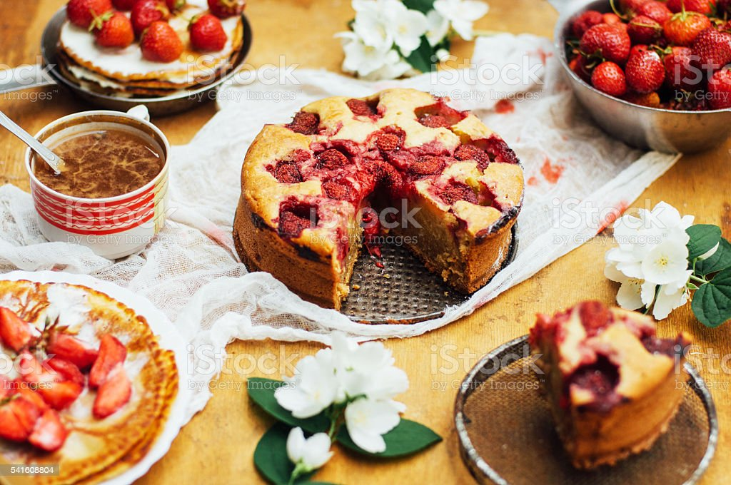 Serving homemade strawberry cake or pie on wooden rustic table. stock photo